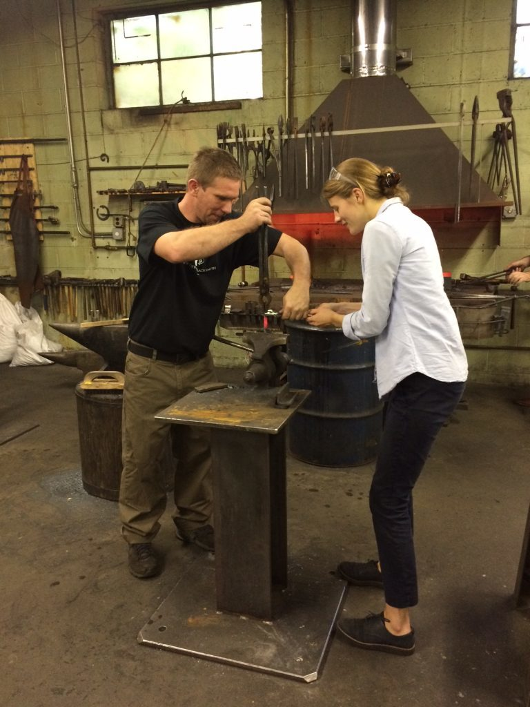 Covax Atelier blacksmith teaches Elaine Rose how to twist iron.