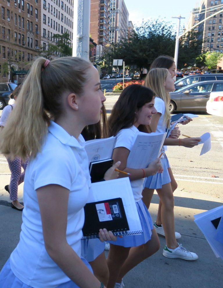 Students on a walking tour of the Upper East Side in Manhattan, sketchbooks in hand