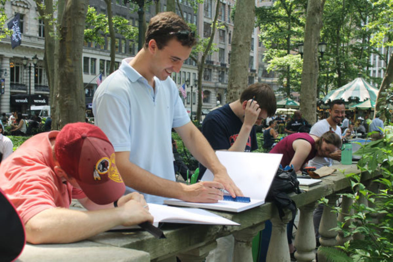 CUA Students Daniel Glasgow, Chas Winebrenner, Andrew Anderson and Tatiana Amundsen sketch on location in Bryant Park during the Summer Studio