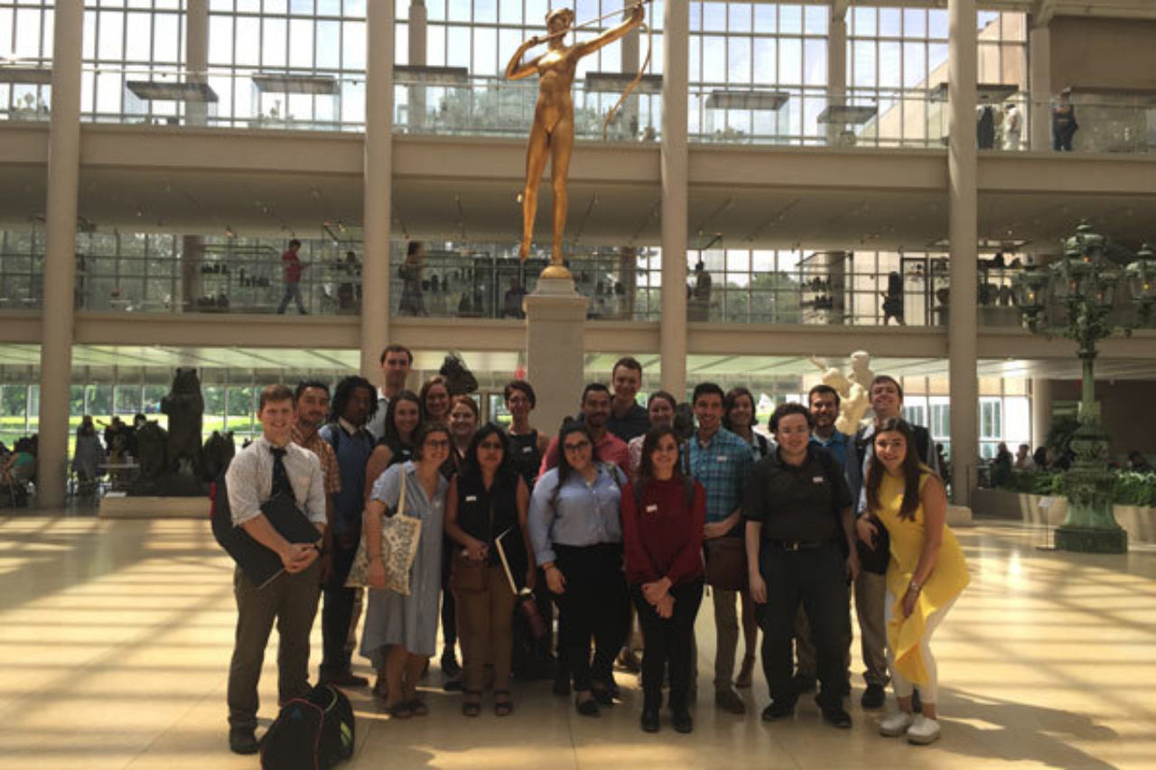 The Summer Studio group stands in front of the statue of Diana during a field study at The Metropolitan Museum of Art