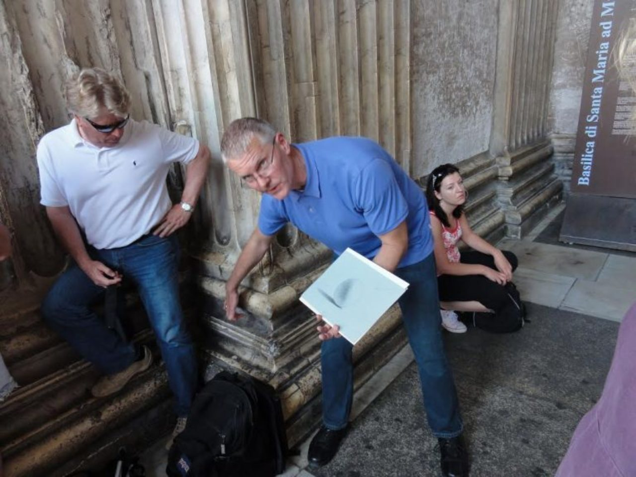 "Fellow Emeritus John Woodrow Kelley giving a lecture in the Portico of the Pantheon in Rome on the basics of light and shadow for the 2010 Rome drawing tour. ""That morning some of the students requested some instruction on the subject, so during the lunch break I prepared some demonstration drawings and used the plinth and torus of one of the pilasters in the Pantheon portico as a study model,"" John reminisced."