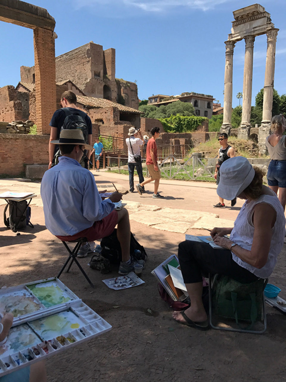 Tour participants sketch on location in the Roman Forum