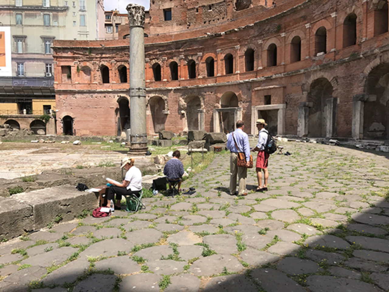 Tour participants sketch on location at Trajan's Market