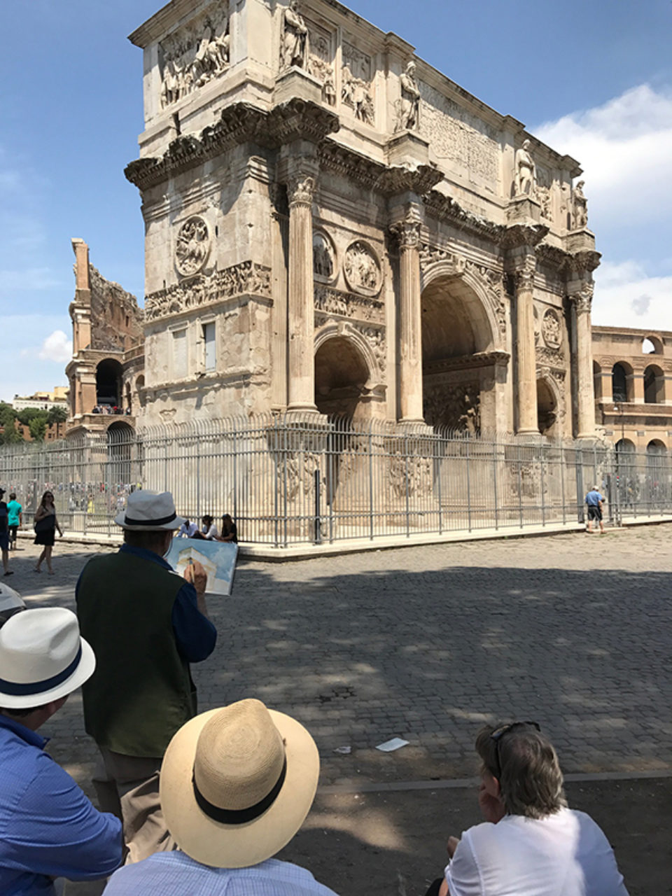 Tour participants sketch on location at the Arch of Constantine