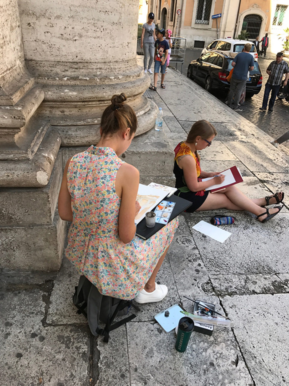 Tour participants sketch at Piazza Sant'Ignazio in Rome