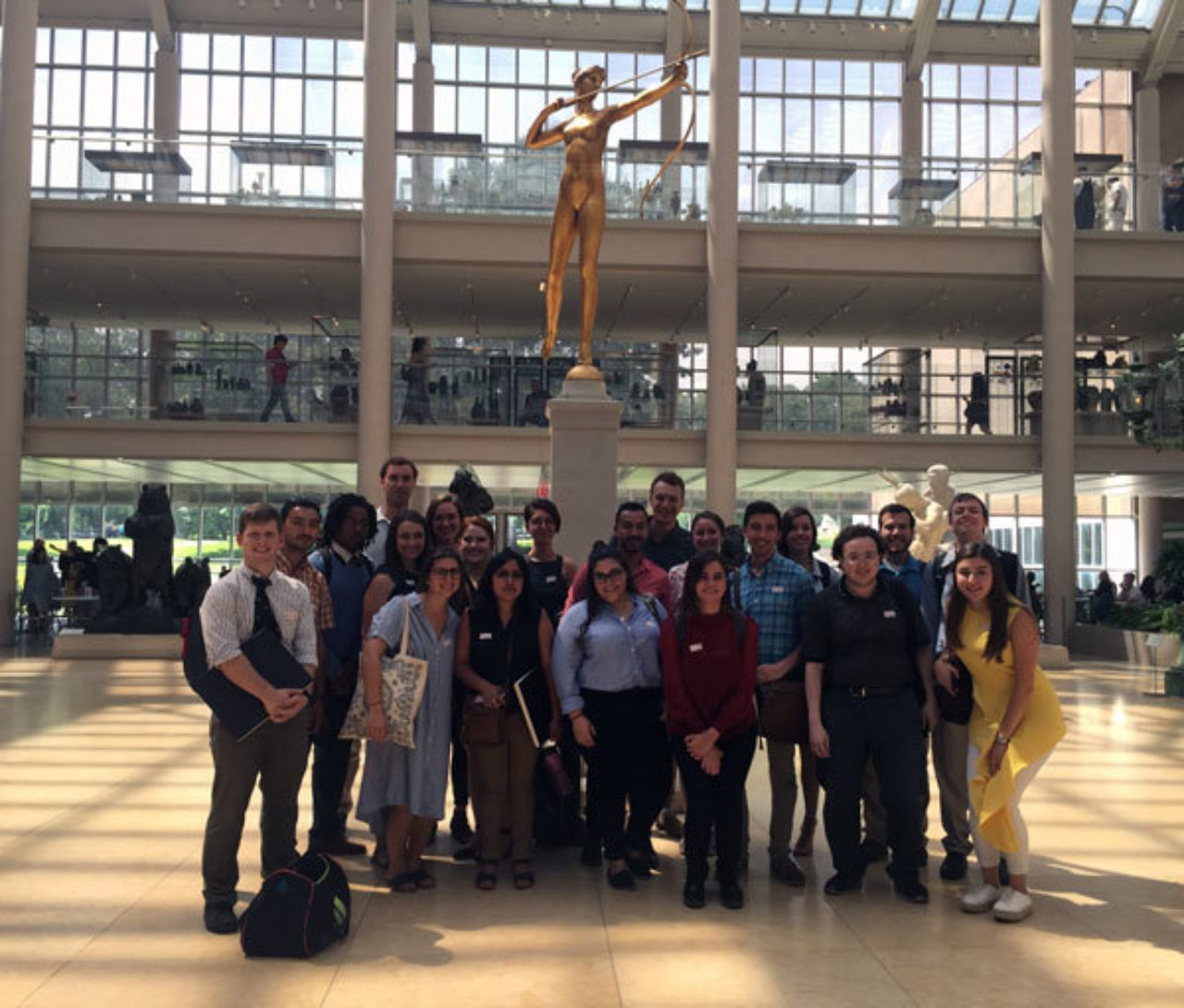 The Summer Studio group stands in front of the statue of Diana at The Metropolitan Museum of Art