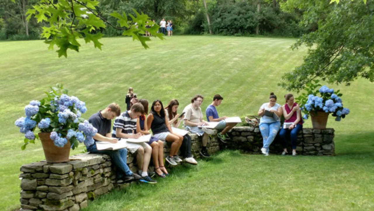 Students sketch on the grounds of architect Gil Schafer III's house