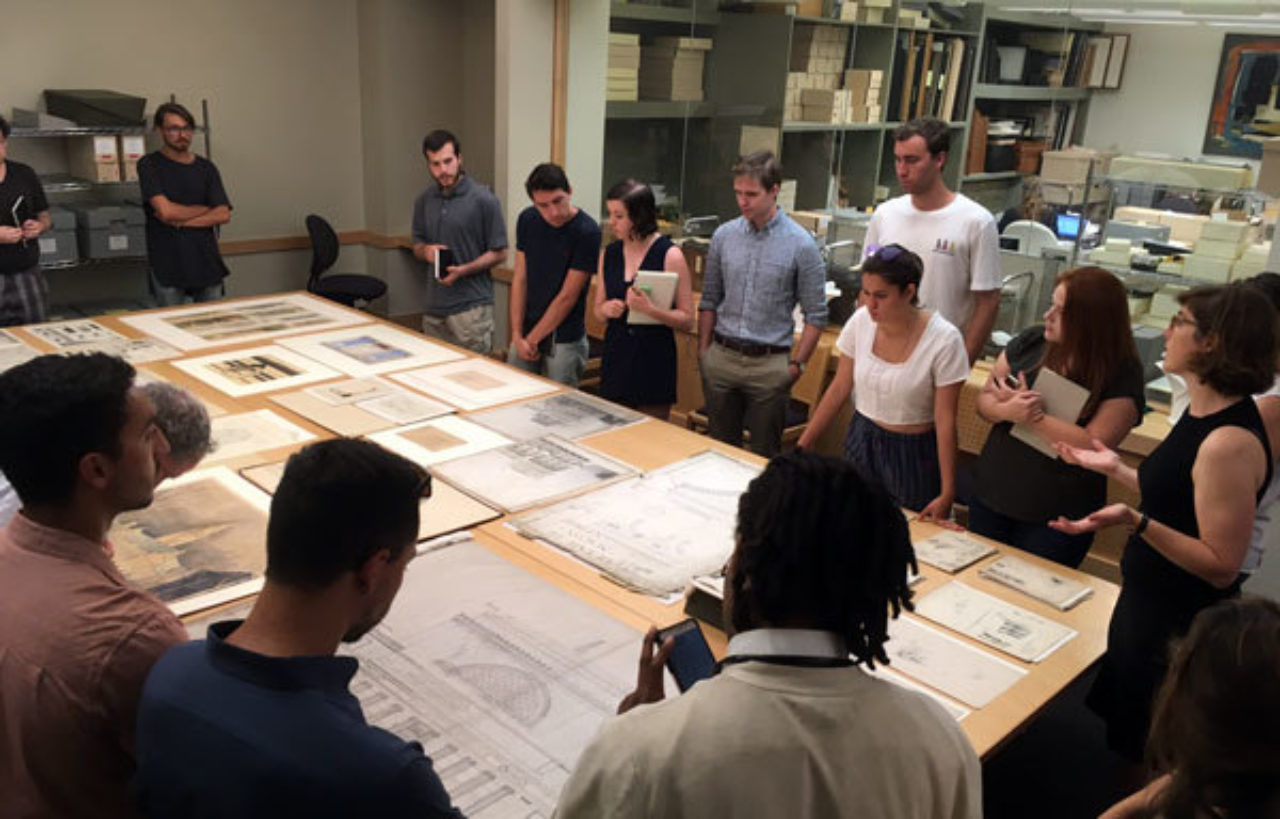 Students look at original work in the Avery Architectural and Fine Arts Library