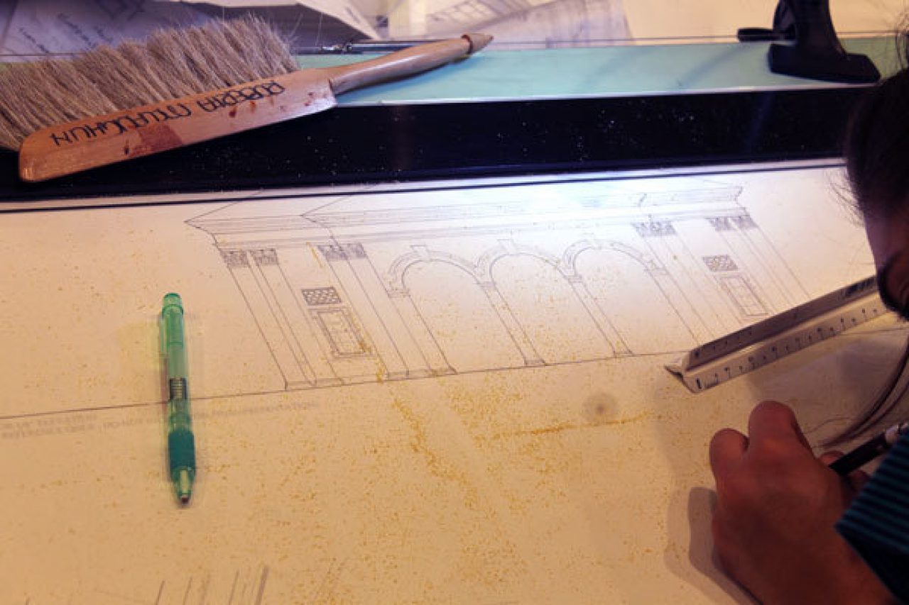 A student makes adjustments to their final design
