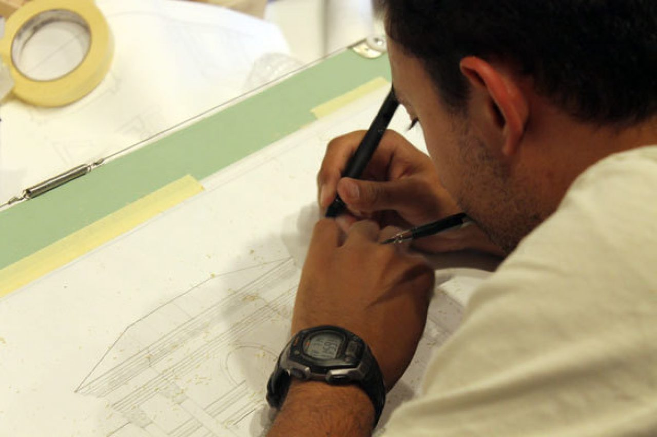A student works on his final design for the Summer Studio