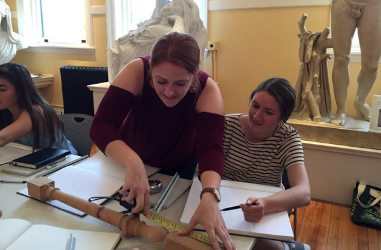 Students measure balusters in the ICAA's Cast Hall
