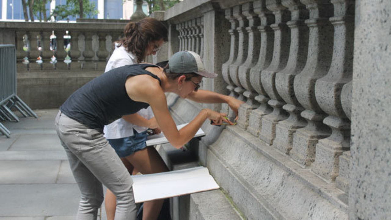 Students measure balustrades in Bryant Park, NY