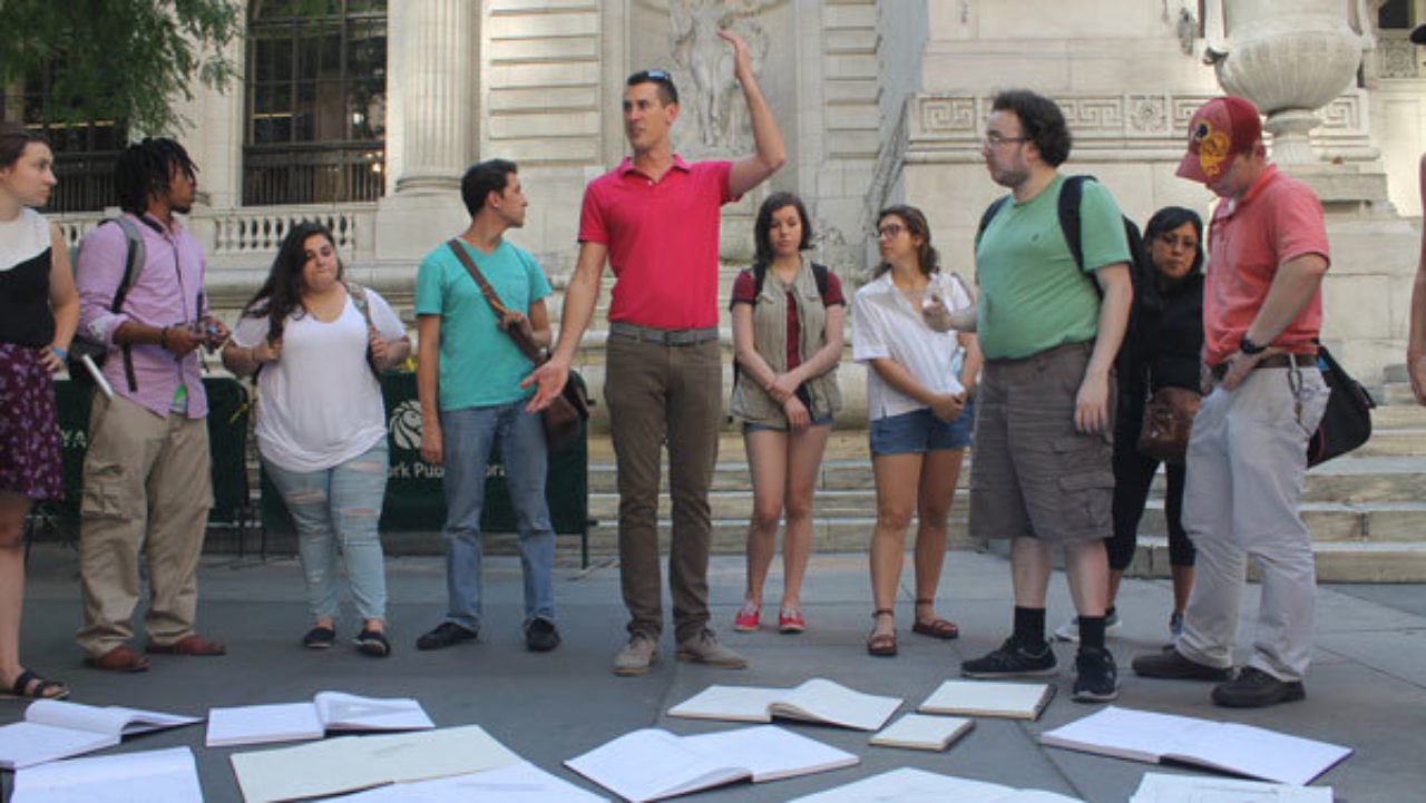 Led by Kellen Krause, students compare their sketches outside the New York Public Library