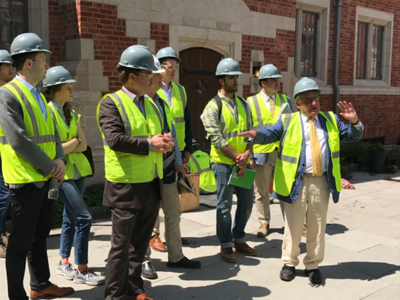 Robert A.M. Stern leads the ICAA's tour group through Yale's new residential colleges