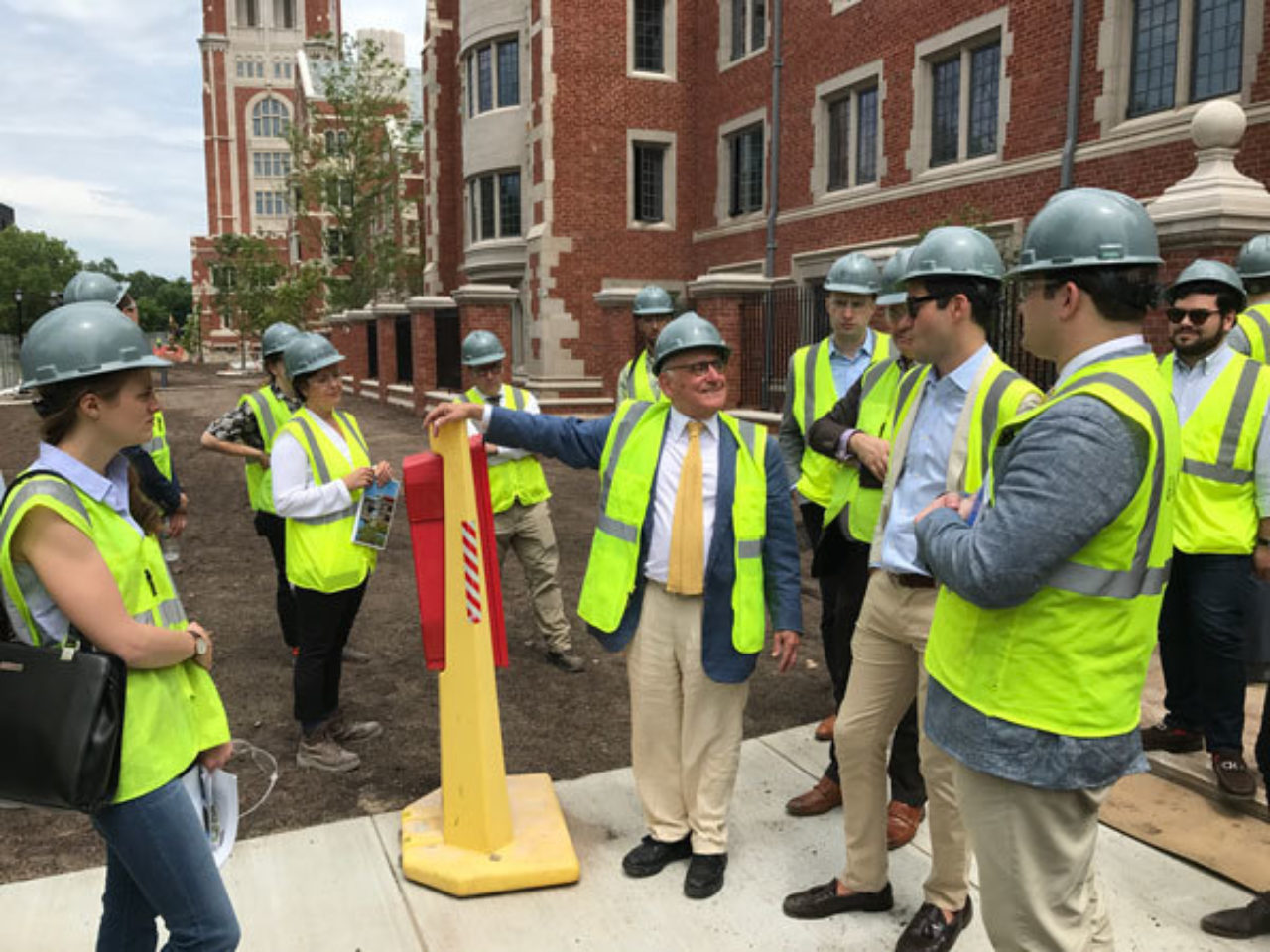 Robert A.M. Stern leads the ICAA's tour group through the new residential colleges