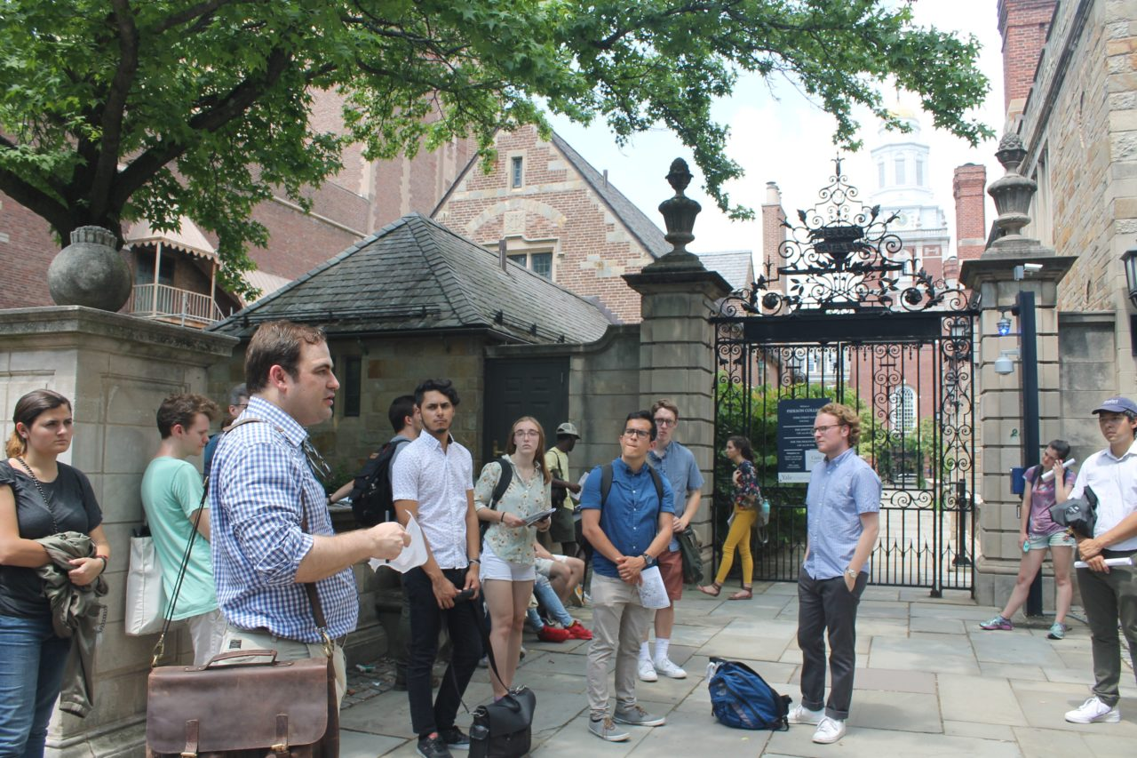 Instructor Clay Hayles teaching students about Yale's campus